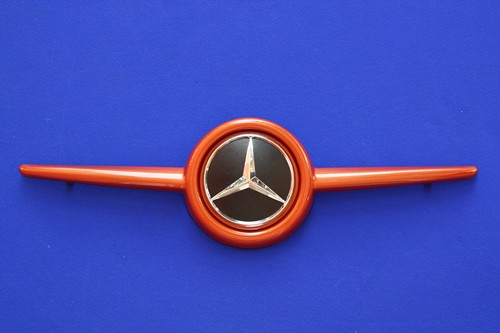 This is the Front Grille, available for the new Smart Fortwo 453 in Lava Orange Metallic color with the original Mercedes-Benz Emblem.