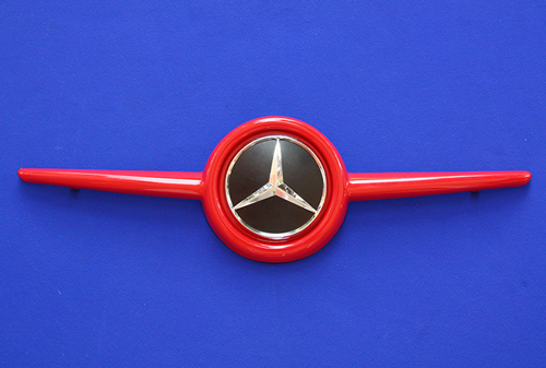 This is the Front Grille, available for the new Smart Fortwo 453 in Rally Red Metallic color with the original Mercedes-Benz Emblem.