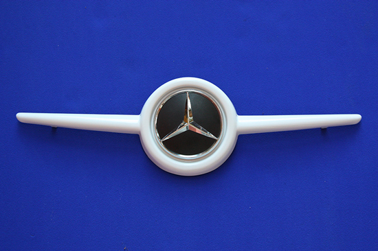 This is the Front Grille, available for the new Smart Fortwo 453 in White color with the original Mercedes-Benz Emblem.