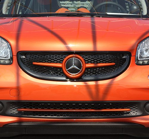he Front end of the new Smart Fortwo 453 in Lava Orange, customized by Smart Power Design.