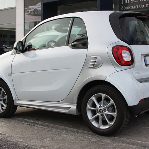 This is the rear view of a Smart Fortwo 453 with Smart Power Design's Fender Flares and Side Skirts installed.