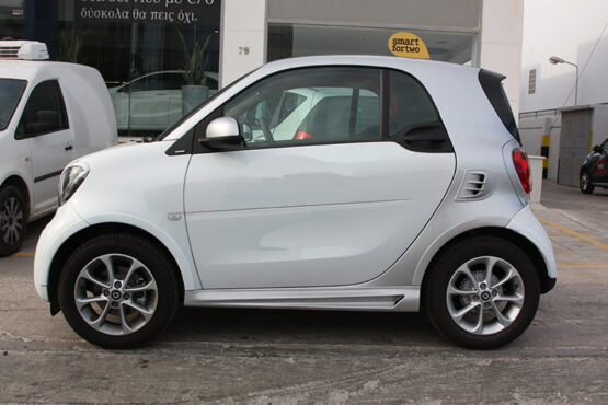 These are the Side Skirts for the Smart Fortwo 453, in Cool Silver Metallic color, brought to you by Smart Power Design. The Fender Flares are also installed.