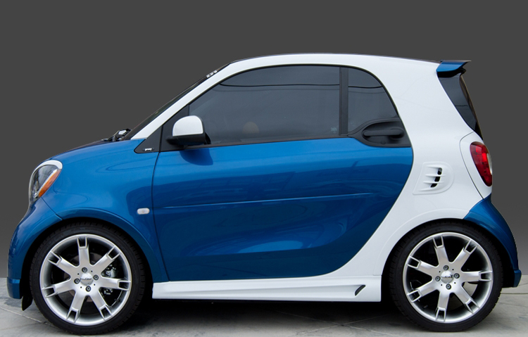 These are the Side Skirts for the Smart Fortwo 453, in White color, brought to you by Smart Power Design. The Fender Flares are also installed.