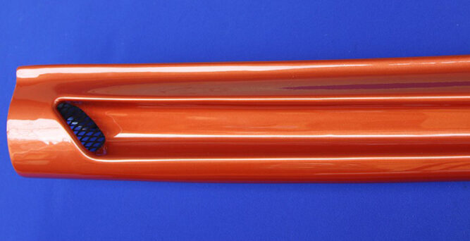 Look at the detailed finish of the Side Skirts for Smart Fortwo 453, in Lava Orange Metallic color.