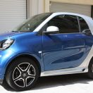 This is the side view of a Smart Fortwo 453 with installed the Fender Flares (in Midnight Blue with Silver Tridion color) , the Side Skirts and the Air Scoop.
